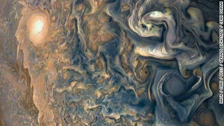 No, this is not a painting. It's a closeup of Jupiter's swirling cloud systems.