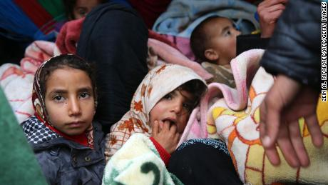 Syrians who fled Idlib province take shelter at a camp near the Turkish border on Thursday.