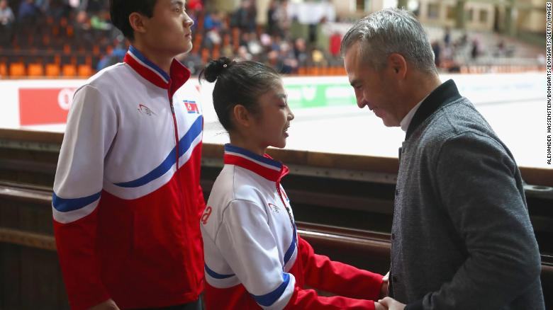 Ryom and Kim speak with Canadian coach Bruno Marcotte prior to their Pairs free skating during the 49th Nebelhorn Trophy in September 2017.
