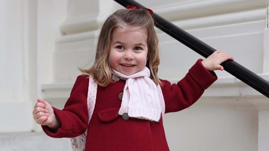 Princess Charlotte smiles in a handout picture provided by the Duke and Duchess of Cambridge as she prepares for her first day at the Willcocks Nursery School in London on Monday, January 8. She is fourth in line to the British throne behind her grandfather, Prince Charles; her father, Prince William; and her big brother, Prince George.