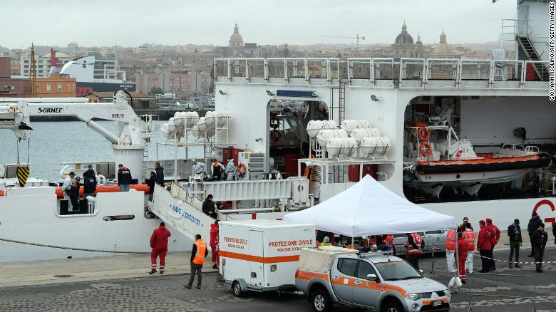 Bodies recovered from a wreck off the coast of Libya are taken ashore in Italy on Monday.