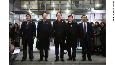 South Korean Unification Minister Cho Myoung-gyon, center, poses with other delegates before leaving for the border village of Panmunjom to attend South and North Korea meeting, at the Office of the South Korea-North Korea Dialogue in Seoul, South Korea, Tuesday, Jan. 9, 2018. (AP Photo/Ahn Young-joon)