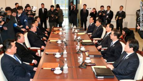 South Korean Unification Minister Cho Myoung-gyon, third from right, and the head of North Korean delegation Ri Son Gwon, third from left, with their delegation meet at the Panmunjom in the Demilitarized Zone in Paju, South Korea, Tuesday, Jan. 9, 2018. South Korean media said North and South Korea have begun talks at their border about how to cooperate in next month's Winter Olympics and how to improve their long-strained ties. (Korea Pool/Yonhap via AP)