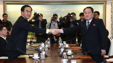 PANMUNJOM, SOUTH KOREA - JANUARY 09:  South Korean Unification Minister Cho Myoung-gyon (L) shakes hands with the head of North Korean delegation Ri Son-Gwon (R) before their meeting at the Panmunjom in the Demilitarized Zone on January 9, 2018 in Panmunjom, South Korea. South and North Korea are scheduled to begin their first official face-to-face talks in two years on Tuesday, January 9, 2017.  (Photo by Korea Pool/Getty Images)