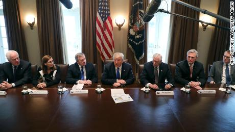 WASHINGTON, DC - JANUARY 09:  U.S. President Donald Trump (C) presides over a meeting about immigration with Republican and Democrat members of Congress, including (L-R) Senate Majority Whip John Cornyn (R-TX), Rep. Martha McSally (R-AZ), Senate Minority Whip Richard Durbin (D-IL), House Minority Whip Steny Hoyer (D-MD), House Majority Leader Kevin McCarthy (R-CA) and Sen. James Lankford (R-OK) in the Cabinet Room at the White House January 9, 2018 in Washington, DC. In addition to seeking bipartisan solutions to immigration reform, Trump advocated for the reintroduction of earmarks as a way to break the legislative stalemate in Congress.  (Photo by Chip Somodevilla/Getty Images)