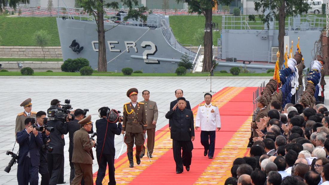 Noth Korean leader Kim Jong Un salutes as he walks in front of the USS Pueblo in Pyongyang on July 27, 2013.