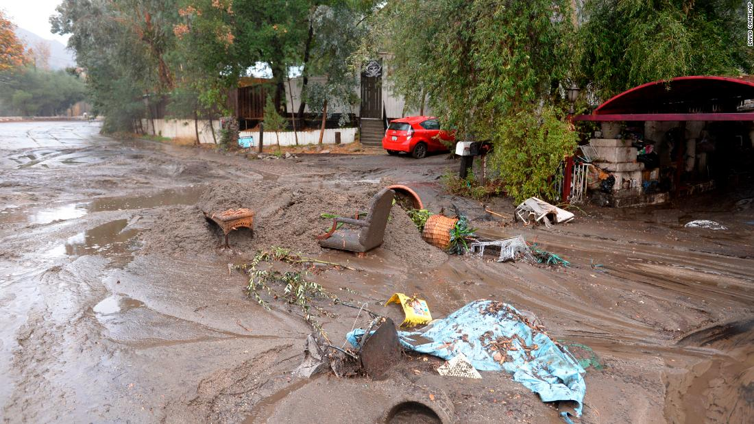 Mud washes away personal belongings in the Sun Valley neighborhood of Los Angeles on January 9.