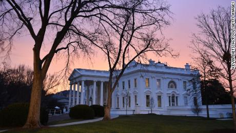 WASHINGTON, DC - JANUARY 20:  Dawn breaks behind the White House as the nation prepares for the inauguration of President-elect Donald Trump on January 20, 2017 in Washington, D.C.  Trump becomes the 45th President of the United States.    (Photo by Kevin Dietsch-Pool/GettyImages)