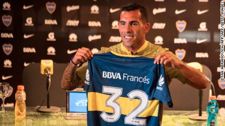 Boca Juniors' newly returned player Carlos Tevez poses with his new jersey during his official presentation at Los Cardales, Buenos Aires province, on January 09, 2018.  Former Manchester United and Juventus striker Carlos Tevez agreed a move back to boyhood club Boca Juniors for the third time in his carreer. / AFP PHOTO / EITAN ABRAMOVICH        (Photo credit should read EITAN ABRAMOVICH/AFP/Getty Images)