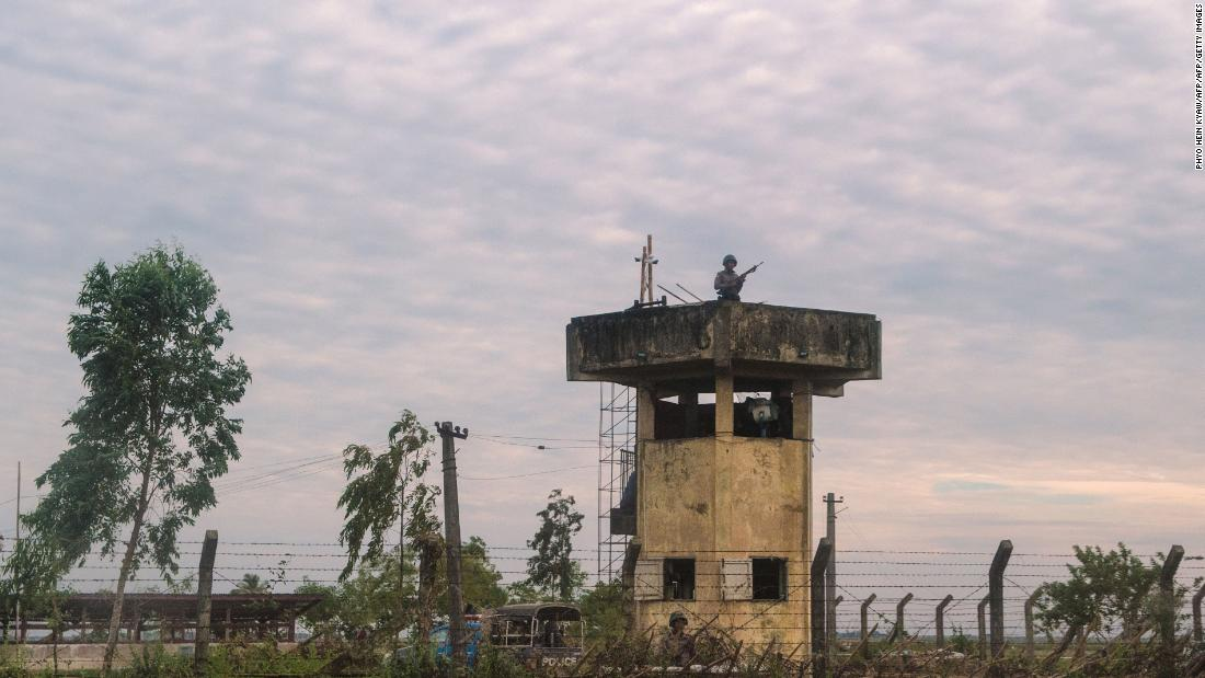 In this photograph taken on November 12, 2017, border guards keep watch near a border post in Rakhine state in Myanmar.