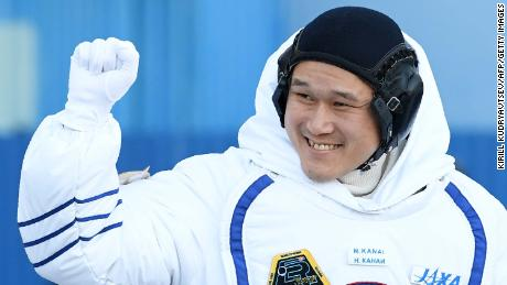 Japanese astronaut Norishige Kanai waves during a send-off ceremony ahead of his deployment to the International Space Station in December.