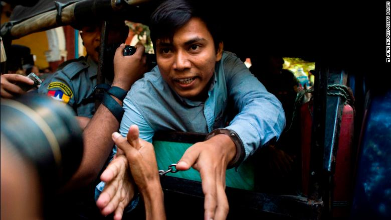 Reuters journalist Kyaw Soe Oo (C) talks to the media as he leaves after a court appearance in Yangon on January 10, 2018.