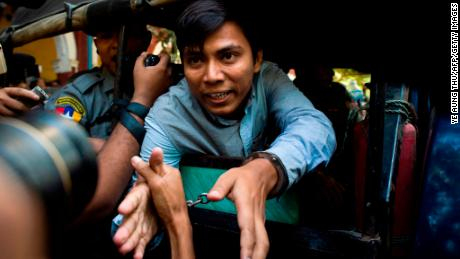 Reuters journalist Kyaw Soe Oo (C) talks to the media as he leaves after a court appearance in Yangon on January 10, 2018. Myanmar police formally filed charges on January 10 against two Reuters reporters accused of breaching the Official Secrets Act, a judge said, an offence that carries up to 14 years in prison. / AFP PHOTO / YE AUNG THU        (Photo credit should read YE AUNG THU/AFP/Getty Images)