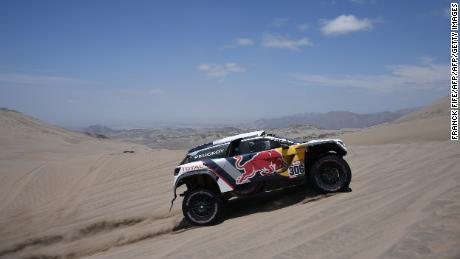 Peugeot's French driver Sebastien Loeb and co-driver Daniel Elena compete during the Stage 4 of the 2018 Dakar Rally in and around San Juan de Marcona, Peru, on January 9.