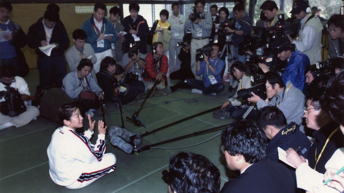 "Tani's single minded motto was ""minimum gold, maximum gold,"" as she tells reporters here ahead of the Sydney 2000 Olympic Games. She would go on to triumph."