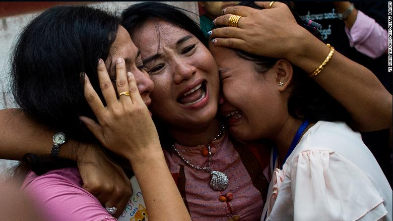 Family members react as Reuters journalist Kyaw Soe Oo leaves after a court appearance in Yangon on January 10, 2018.