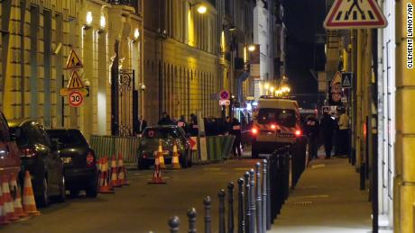"In this image made from video, French police attend the scene outside the Ritz Hotel in Paris, France, after a robbery Wednesday evening Jan. 10, 2018.  Police said Wednesday that five people, at least some armed, entered the luxury Ritz Hotel and made off with goods, likely to be jewels, worth ""an important"" sum, and reported that three robbers were arrested and two escaped capture."