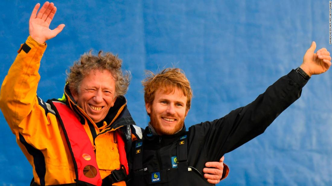 Gabart celebrates with his routing manager Jean-Yves Bernot, who helped him navigate the high seas from dry land.