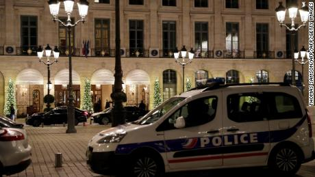 A picture shows a police car parked outside the Ritz luxury hotel in Paris on January 10, 2018, after an armed robbery. Armed robbers made off with millions of euros worth of jewellery after smashing the windows of the world-famous Ritz hotel in Paris on January 10, police said, adding that three suspects had been detained. / AFP PHOTO / Thomas SAMSON        (Photo credit should read THOMAS SAMSON/AFP/Getty Images)