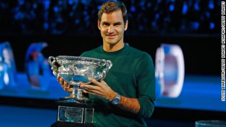 MELBOURNE, AUSTRALIA - JANUARY 11:  Roger Federer of Switzerland poses with the Norman Brookes trophy during the 2018 Australian Open Official Draw at Melbourne Park on January 11, 2018 in Melbourne, Australia.  (Photo by Scott Barbour/Getty Images)