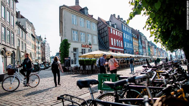 Bicycles line a cobbled street in the Danish capital Copenhagen.