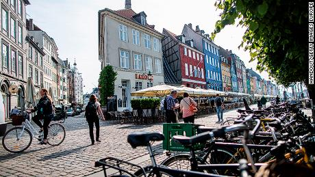 Bicycles line a cobbled street in the Danish capital Copenhagen
