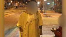 Woman in hospital gown left at bus stop