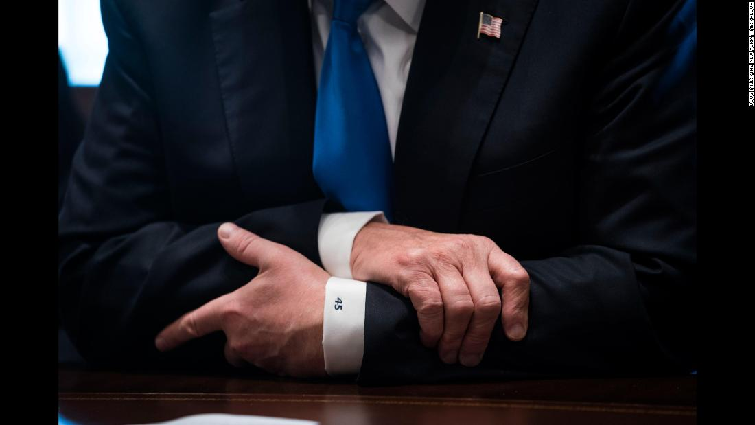 The No. 45 is seen on the shirt cuffs of US President Donald Trump as he meets with lawmakers in Washington on Tuesday, January 9. Trump is the 45th US President.