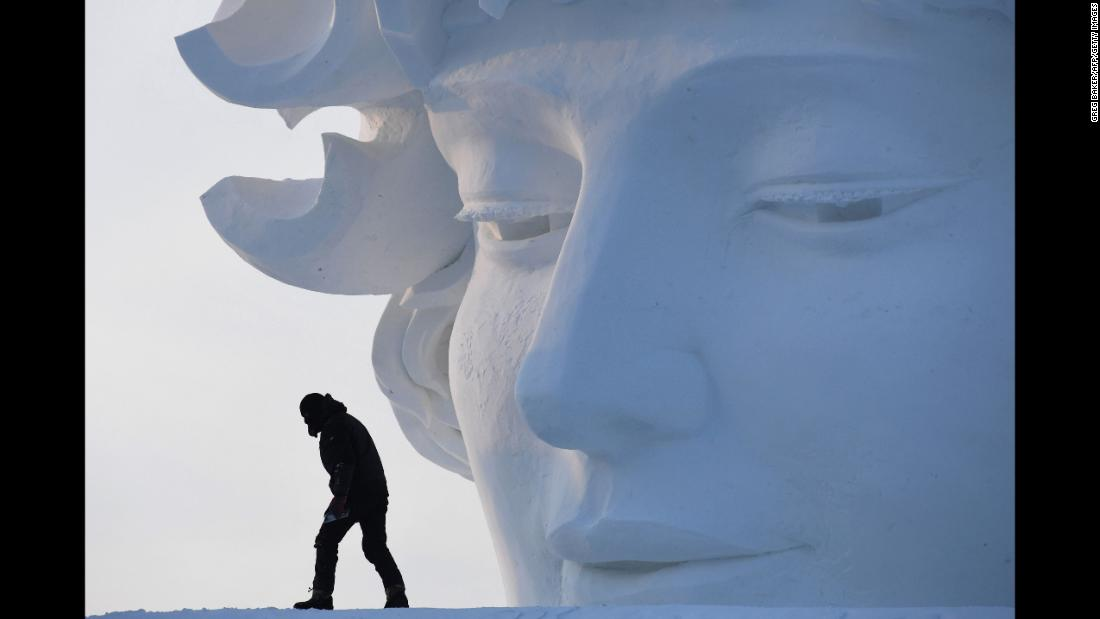A worker walks past a snow sculpture before the opening of the Harbin International Ice and Snow Sculpture Festival on Friday, January 5. The festival in China's northeast Heilongjiang province attracts hundreds of thousands of visitors every year.