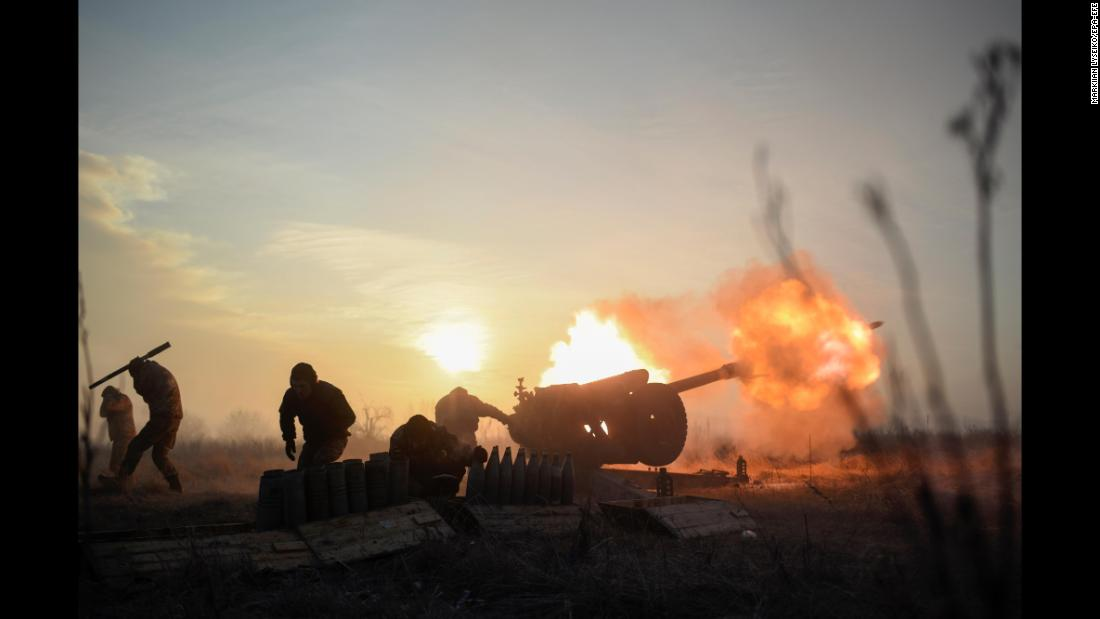 Ukrainian servicemen fire a howitzer at pro-Russian separatists near the Ukrainian village of Novoluhanske on Thursday, January 11.