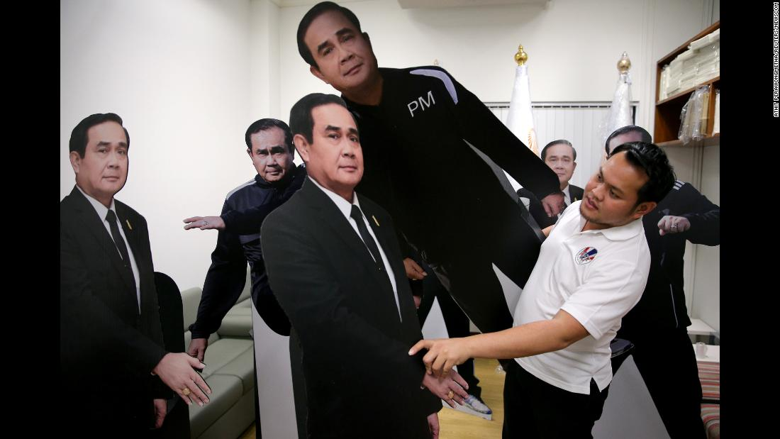 "A government official in Bangkok, Thailand, arranges cardboard cutouts of Thai Prime Minister Prayuth Chan-ocha on Tuesday, January 9. Prayuth put a cutout of himself at a press event and told reporters to talk to it instead of him. <a href=""http://www.cnn.com/videos/world/2018/01/09/thailand-prime-minister-cardboard-cutout-orig-jnd-vstan.cnn"" target=""_blank"">See the video</a>"