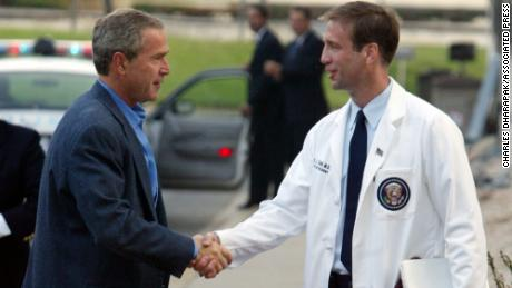President Bush, left, is welcomed by Dr. Richard J. Tubb, physician to the president, at National Naval Medical Center in Bethesda, Md., Saturday, Aug. 2, 2003. President Bush is having his annual medical checkup. (AP Photo/Charles Dharapak)