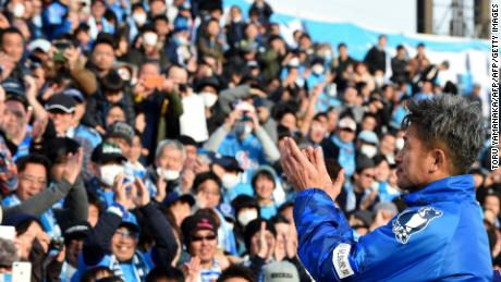 Former Japan striker Kazuyoshi Miura of the J-League second-tier club Yokohama FC (R) celebrated his birthday with fans after the opening match of 2017 season against Matsumoto Yamaga in Yokohama, suburb of Tokyo, on February 26, 2017.   Miura took part in the match on his 50th birthday. / AFP / TORU YAMANAKA        (Photo credit should read TORU YAMANAKA/AFP/Getty Images)