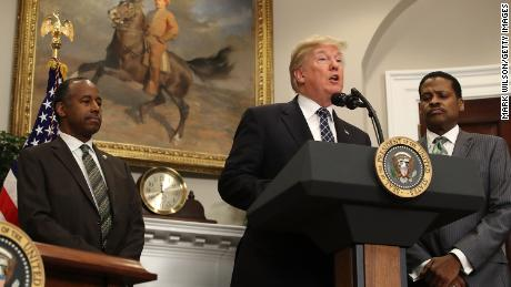 U.S. President Donald Trump speaks while flanked by HUD Secretary Dr. Ben Carson (L) and Isaac Newton Farris, Jr., before signing a proclamation to honor Martin Luther King, Jr. day, in the Roosevelt Room at the White House, on January 12, 2018 in Washington, DC. Monday January 16 is a federal holiday to honor Dr. King and his legacy.  (Photo by Mark Wilson/Getty Images)