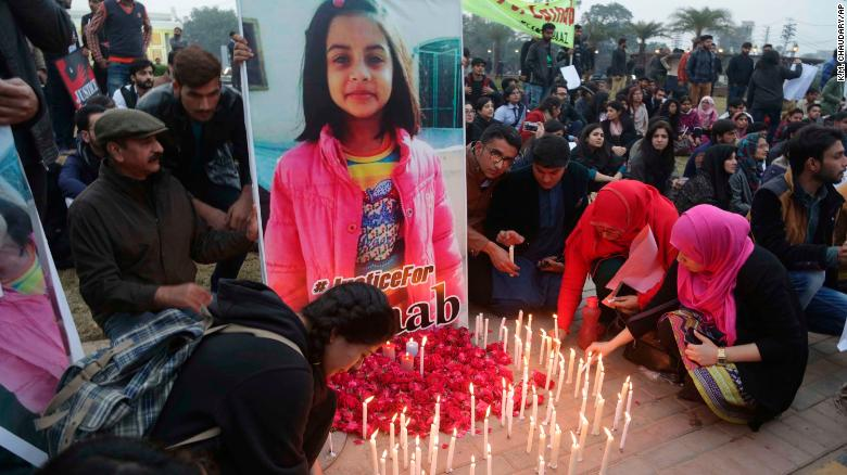 Pakistani students light candles during a protest rally in Lahore on Thursday.