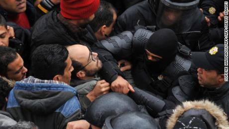 Protesters confront security forces in the capital city of Tunis on Friday, January 12.