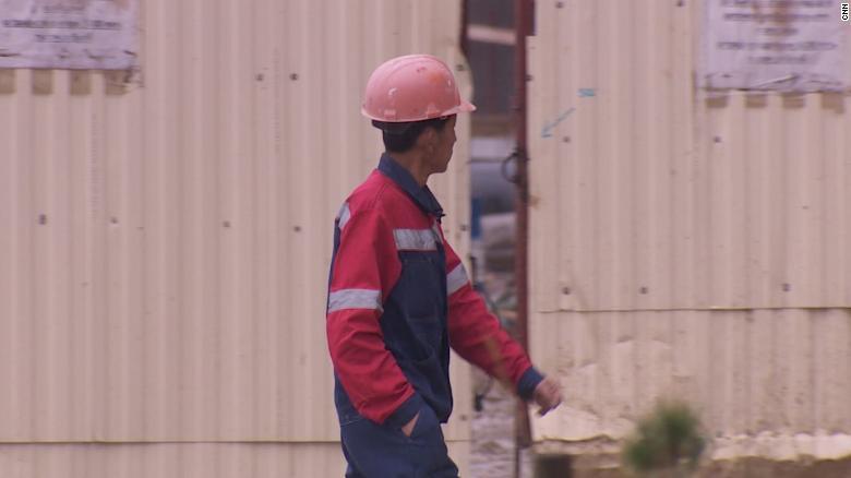 A North Korean worker walks through the building site.