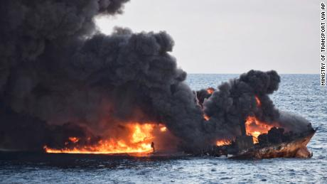 In this Sunday, Jan. 14, 2018 photo provided by China's Ministry of Transport, the burning Iranian oil tanker Sanchi is seen partially sunk in the East China Sea off the eastern coast of China. The fire from the sunken Iranian tanker ship in the East China Sea has burned out, a Chinese transport ministry spokesman said Monday, although concerns remain about possible major pollution to the sea bed and surrounding waters. (Ministry of Transport via AP)