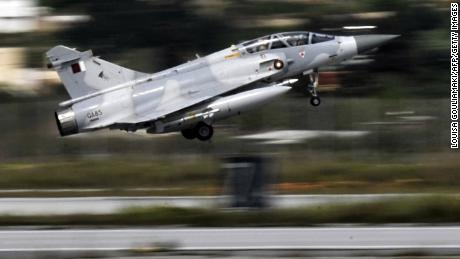 A Qatari Mirage 2000 jet takes off from the military airbase of Souda on the Greek island of Crete for a mission in Libya on March 30, 2011.  Disagreement over arming the rebels battling Libyan leader Moamer Kadhafi emerged today with at least three of the countries enforcing the no-fly zone over the country opposing the idea. AFP PHOTO/ LOUISA GOULIAMAKI (Photo credit should read LOUISA GOULIAMAKI/AFP/Getty Images)