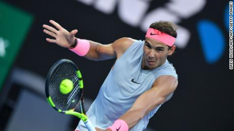 Spain's Rafael Nadal hits a return against Dominican Republic's Victor Estrella Burgos during their men's singles first round match on day one of the Australian Open tennis tournament in Melbourne on January 15, 2018. / AFP PHOTO / Greg Wood / -- IMAGE RESTRICTED TO EDITORIAL USE - STRICTLY NO COMMERCIAL USE --        (Photo credit should read GREG WOOD/AFP/Getty Images)