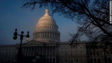 FILE - In this Tuesday, Jan. 9, 2018, file photo, an icy fog cloaking the Capitol begins to give way to the morning sun in Washington. On Thursday, Jan. 11, 2018, the Treasury Department releases federal budget data for December. (AP Photo/J. Scott Applewhite, File)