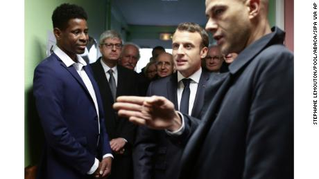 French President Emmanuel Macron during his visit to a migrant center in Croisilles, northern France.