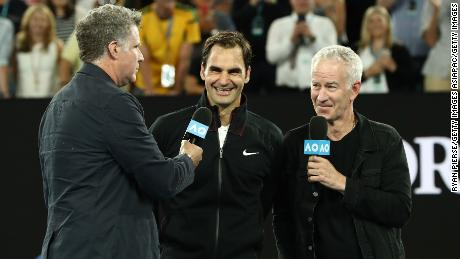 MELBOURNE, AUSTRALIA - JANUARY 16:  Will Ferrell (L) and John McEnroe (R) interview Roger Federer of Switzerland after Federer won his first round match against Aljaz Bedene of Slovenia on day two of the 2018 Australian Open at Melbourne Park on January 16, 2018 in Melbourne, Australia.  (Photo by Ryan Pierse/Getty Images)