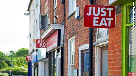 H32W6B Signs - Just Eat - outside take-away food shops, England UK