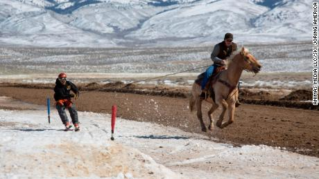 Horse, skier, and rider get to grips with the course in Saratoga, Wyoming.