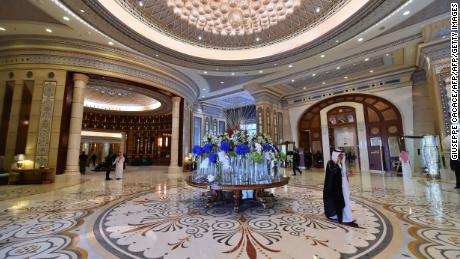 US and Saudi officials walk in the hallway of the hotel in May last year during US President Trump's visit.