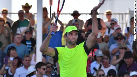 Ivo Karlovic won a marathon in Melbourne for the second straight year.