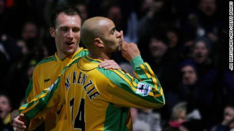NORWICH, UNITED KINGDOM:  Norwich City's Dean Ashton (L) looks on as Leon McKenzie (R) gestures to the crowd after scoring a goal against Chelsea during Premiership football Carrow Road in Norwich, United Kingdom, 05 March 2005. Chelsea beat Norwich City 3-1.   AFP PHOTO/JIM WATSON    (No telcos,website uses to description of licence with FAPL on www.faplwb.com) ...  (Photo credit should read JIM WATSON/AFP/Getty Images)