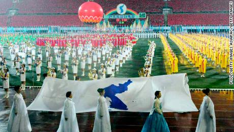 PYONGYANG, NORTH KOREA - JUNE 14: North Koreans hold Korean unification flag during the opening ceremony for the marking of the fifth anniversary of the Inter-Korea Summit at the Kim Il-Sung stadium on June 14, 2005 in Pyongyang, North Korea. The South Korean delegation arrived in the North capital to celebrate the fifth anniversary of the only summit between leaders of the two Koreas amid tension on the divided peninsula over the North's nuclear ambitions. (Photo by Ha Sa-Hun-Pool/Getty Images)