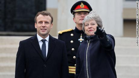 Britain's Prime Minister Theresa May (R) gestures to French President Emmanuel Macron (L) during a ceremony at the Royal Military Academy Sandhurst, west of London on January 18, 2018. French President Emmanuel Macron will take part in a Franco-British summit to discuss migration and Brexit. / AFP PHOTO / Ludovic MARIN        (Photo credit should read LUDOVIC MARIN/AFP/Getty Images)